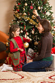 Young and her mother decorating the Christmas tree