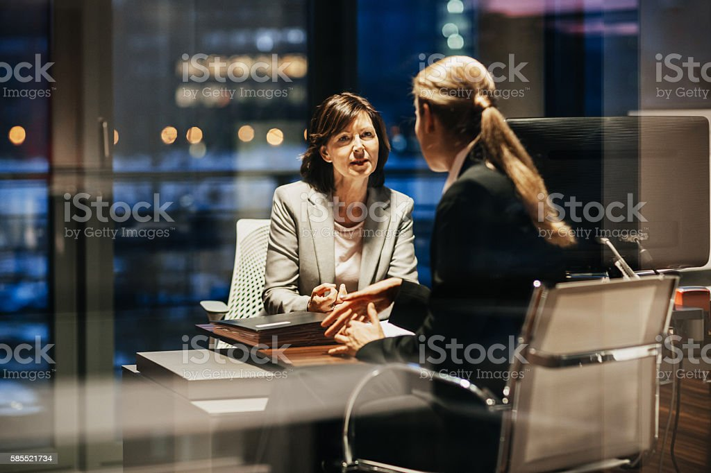 Young and Mature Business Woman Meeting Late stock photo