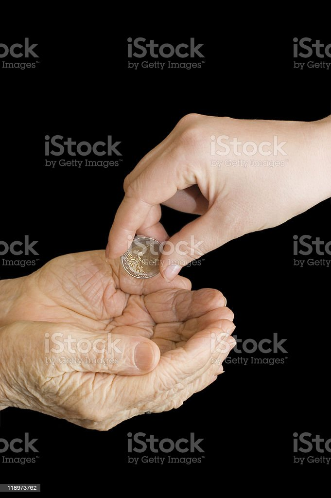 Young and old hand with a coin royalty-free stock photo