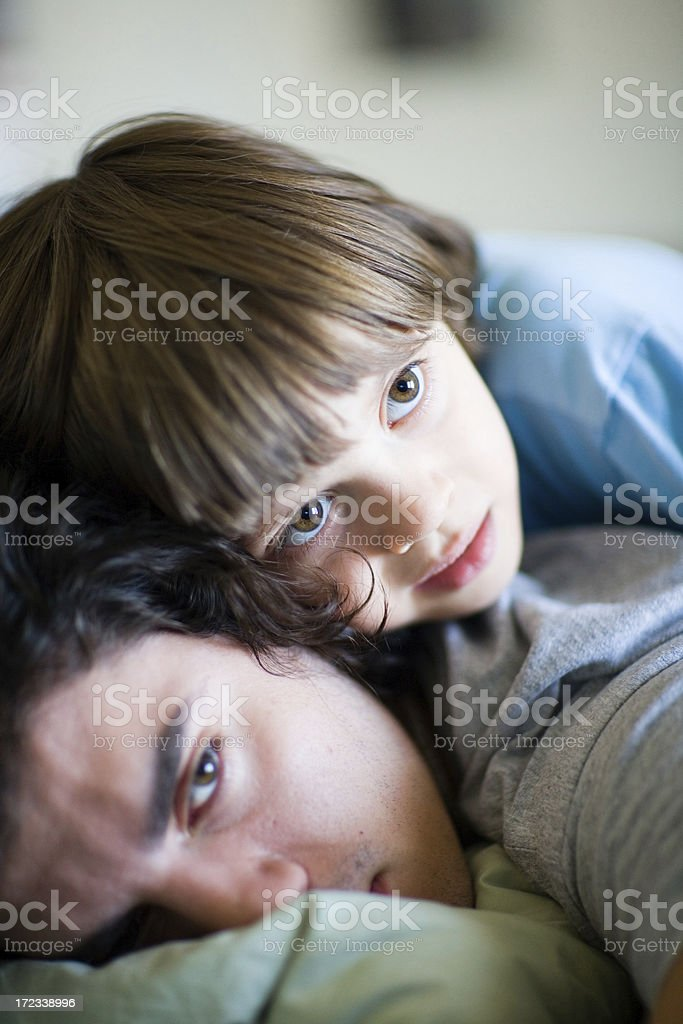 Young and older brother wathing TV stock photo