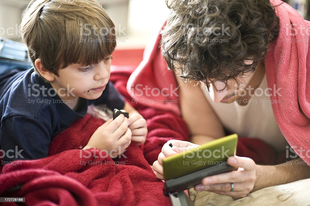 Young and older kid playing video game royalty-free stock photo