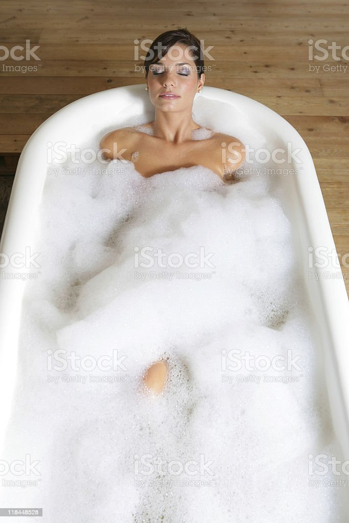 Young and pretty girl takking a foam bath royalty-free stock photo