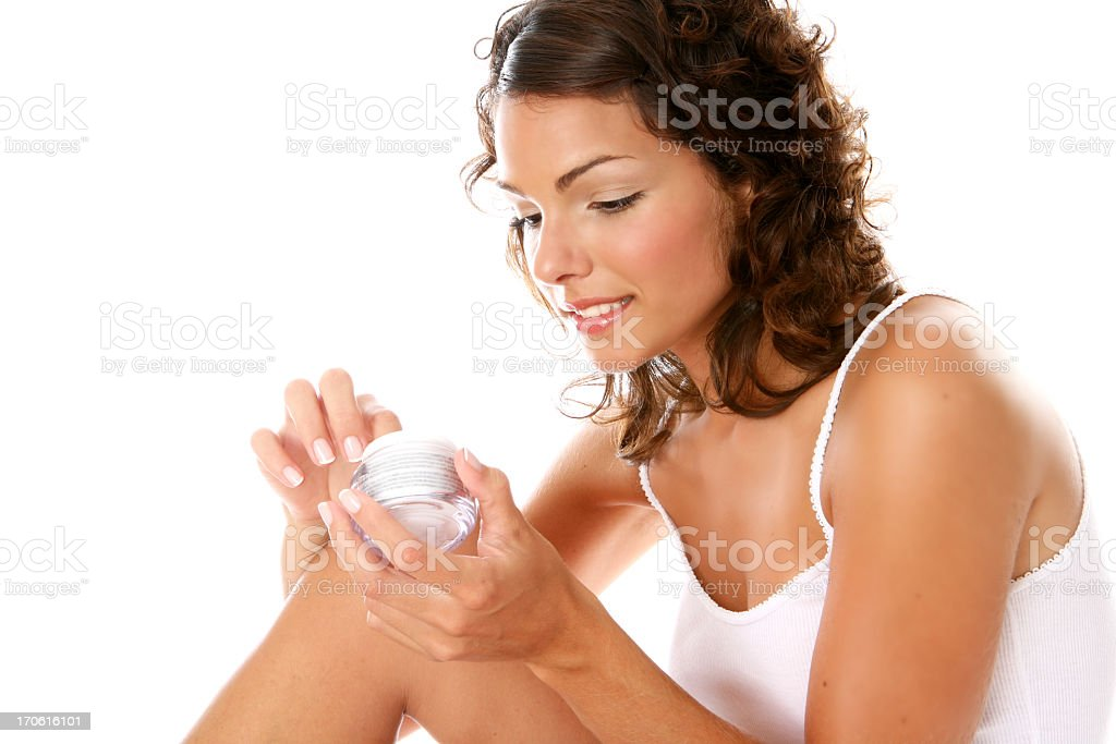 young and pretty woman hold the cream royalty-free stock photo