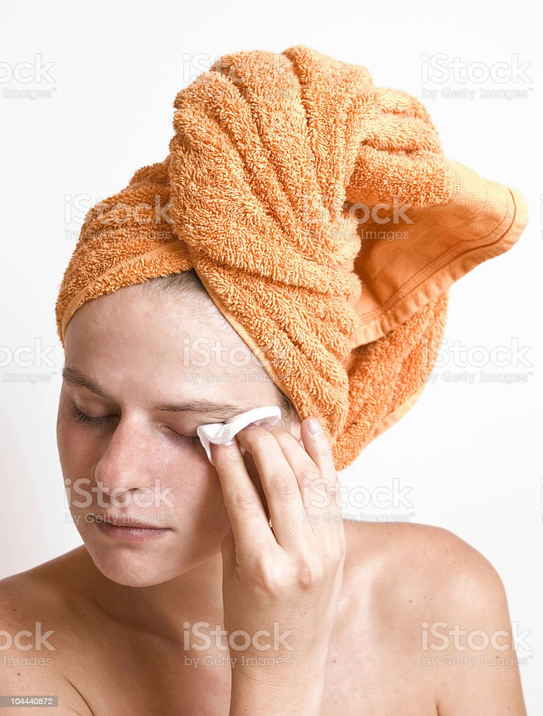 young and pretty woman using cream royalty-free stock photo