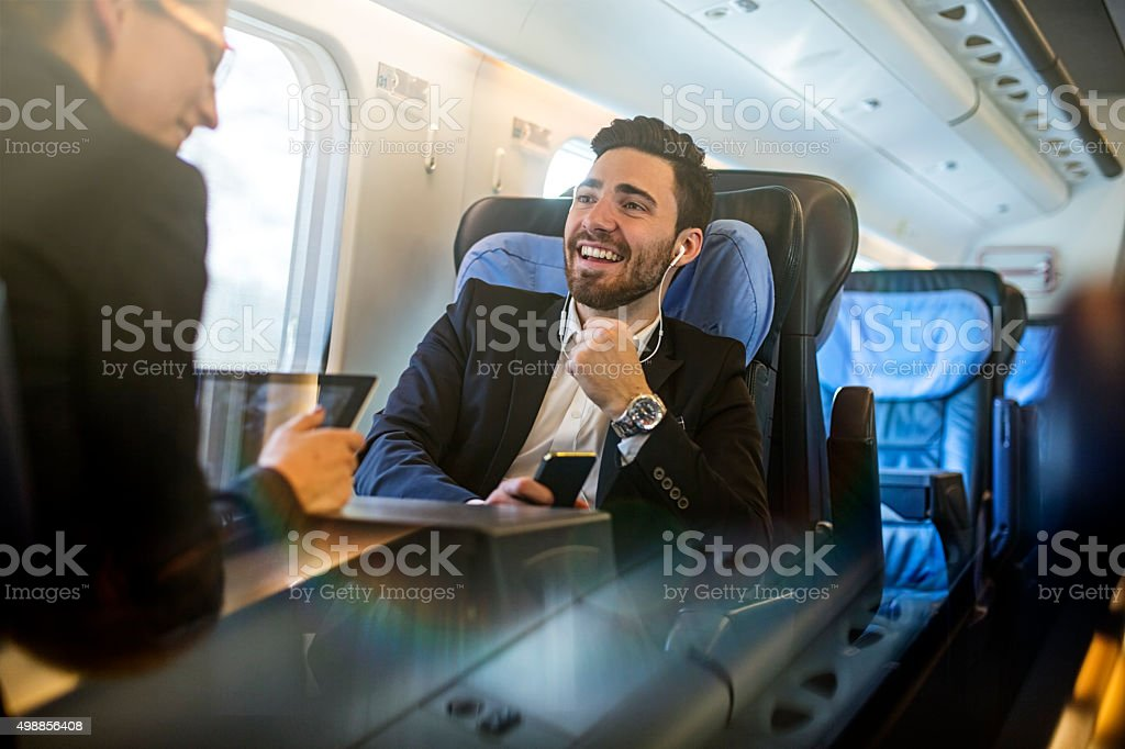 young and professional business coworkers in transit. stock photo