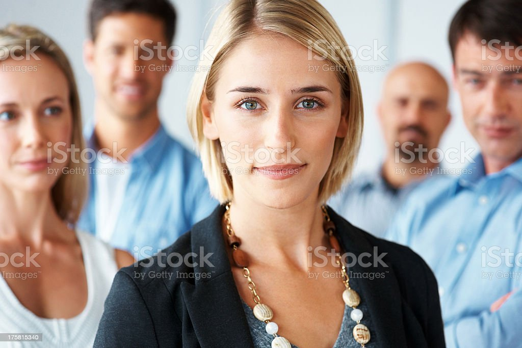 Young and successful business team standing together  stock photo