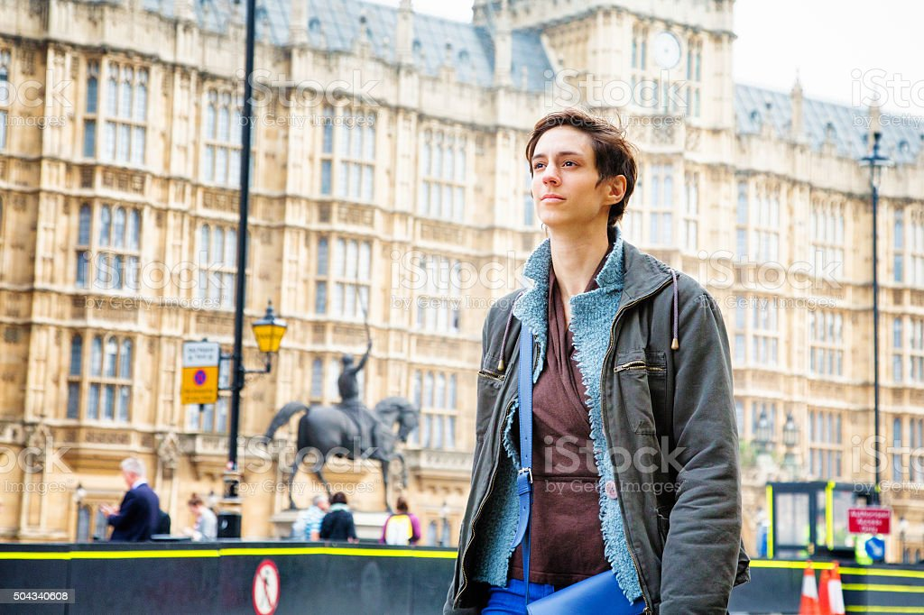Young Androgynous British woman walking in Westminster London UK stock photo