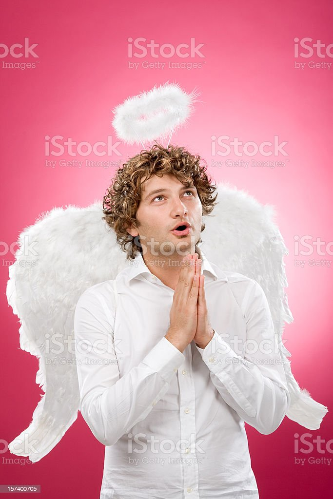 young angel with curly blond hair pray stock photo