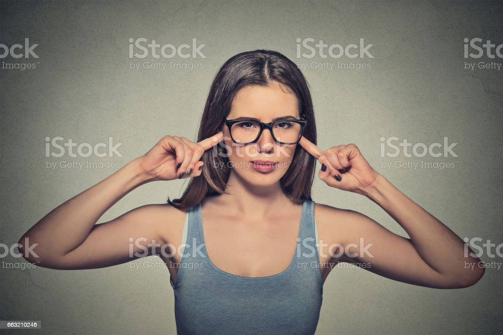 young angry unhappy woman with glasses plugging ears with fingers stock photo