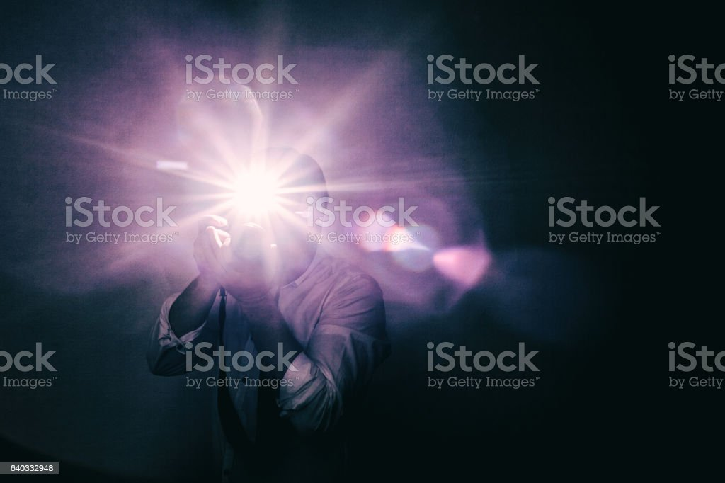 Young annoying fashion photographer in white shirt with sleeves stock photo