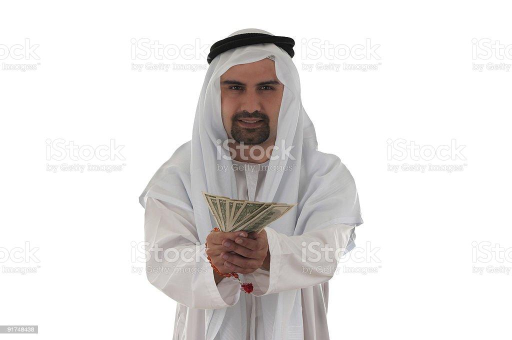 Young Arab businessman holding money stock photo