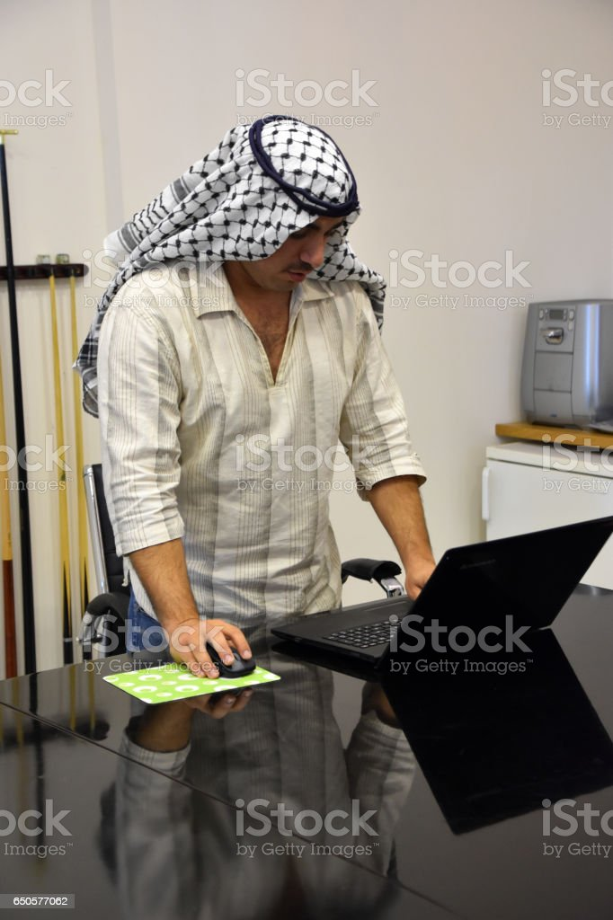 Young Arab man using laptop in Meeting Room stock photo
