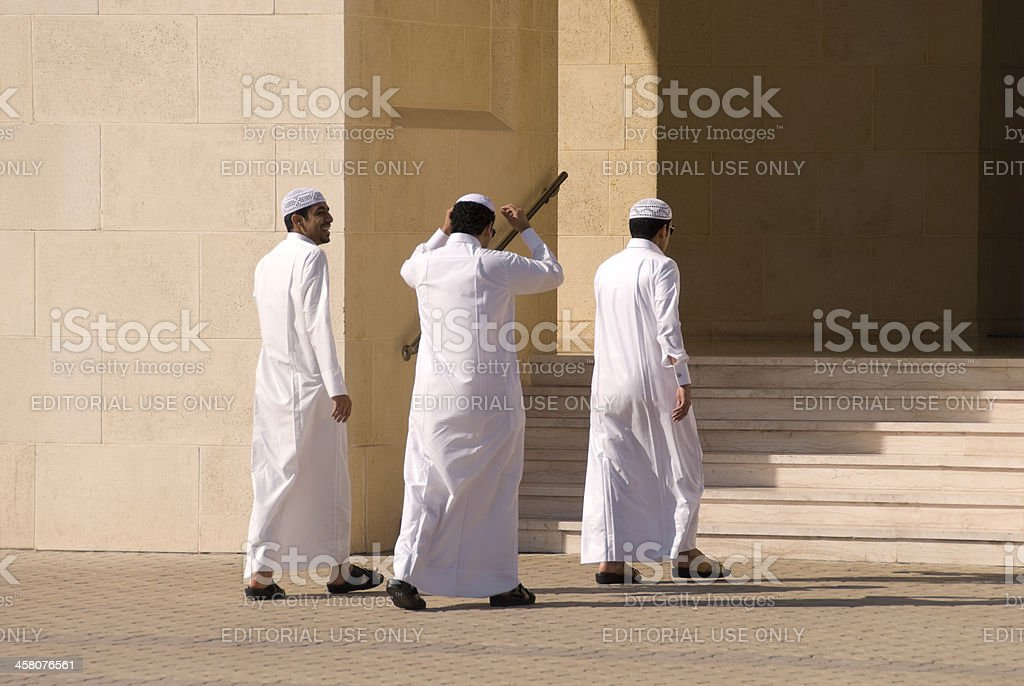 Young Arab Men in Traditional Clothing stock photo
