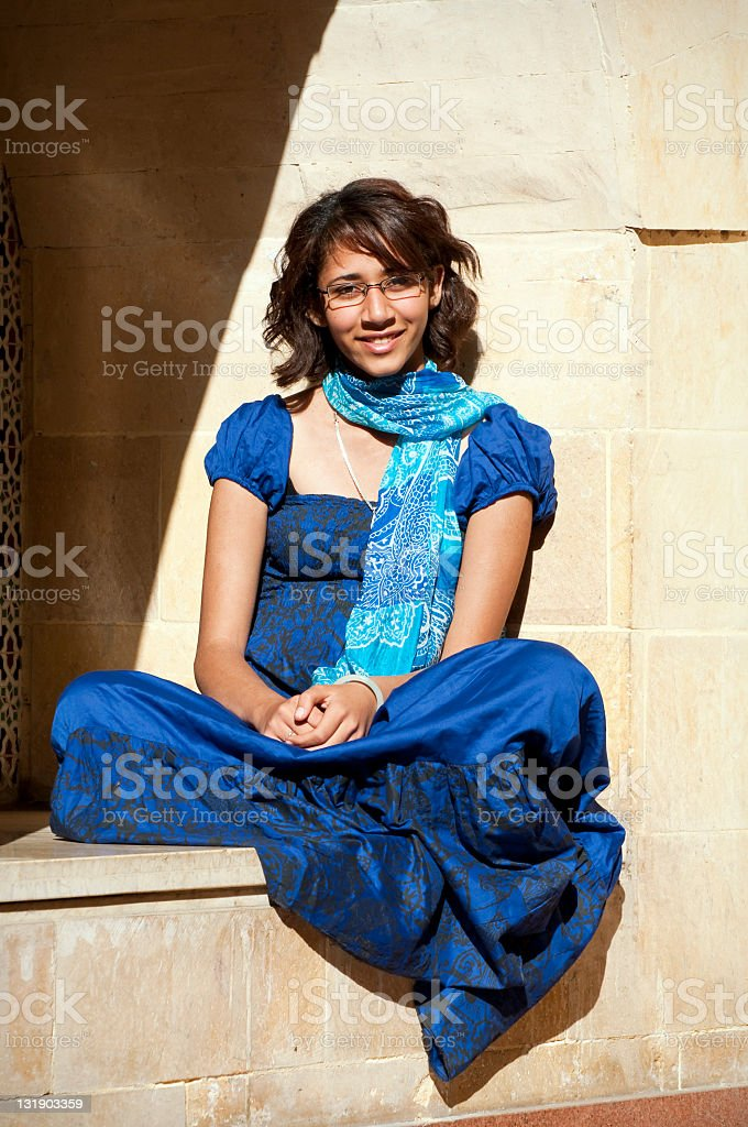Young Arab woman in a blue dress in Cairo, Egypt royalty-free stock photo