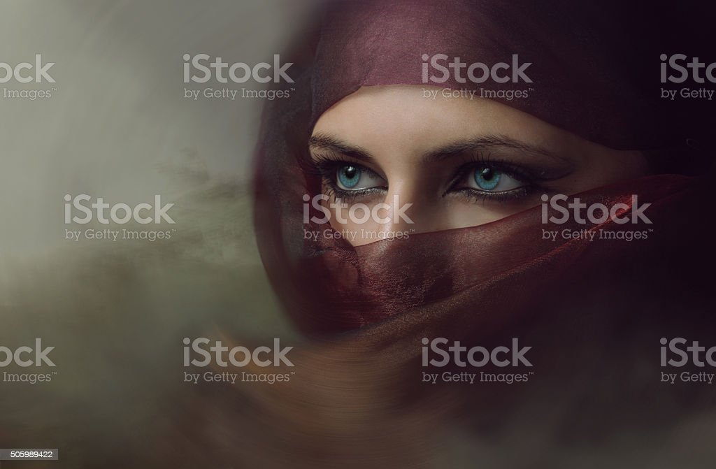 Young arabian woman in hijab with sexy blue eyes. Toning stock photo