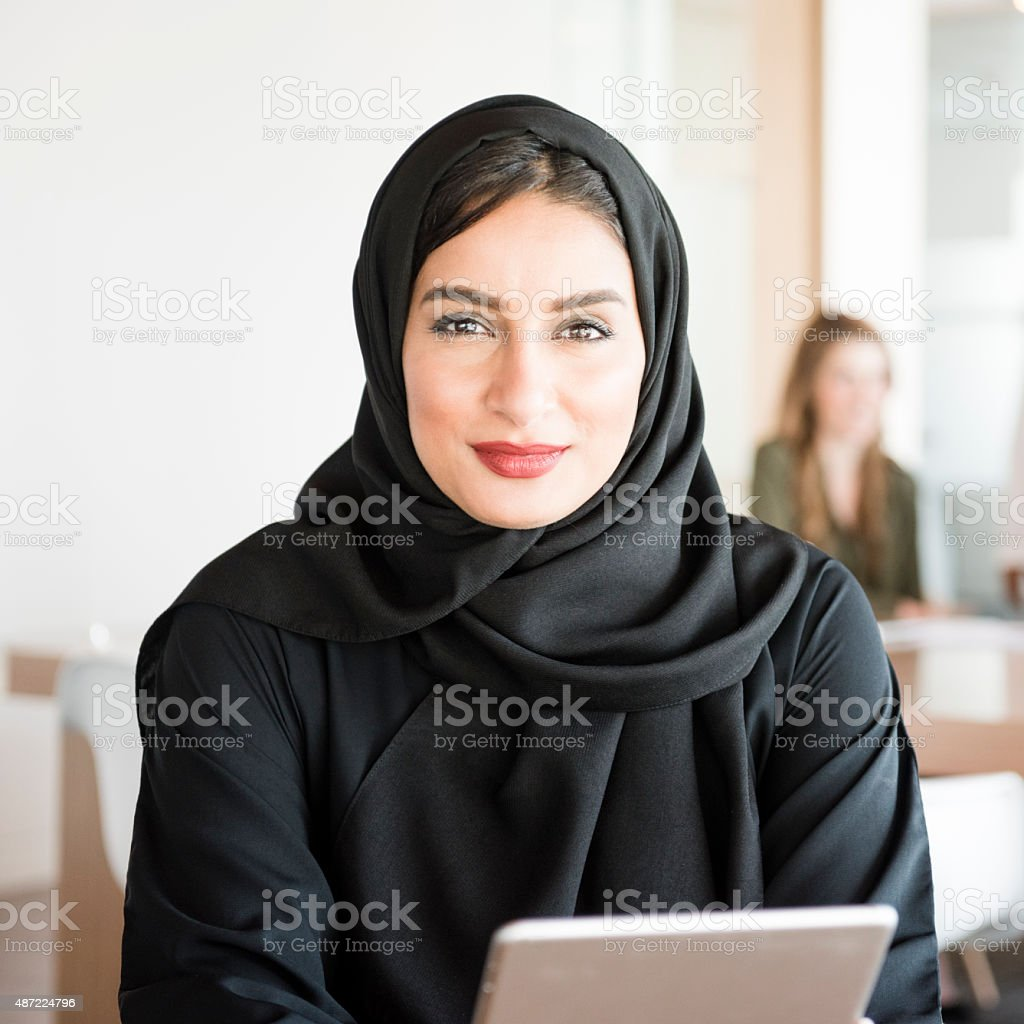 Young Arabic woman in modern office stock photo