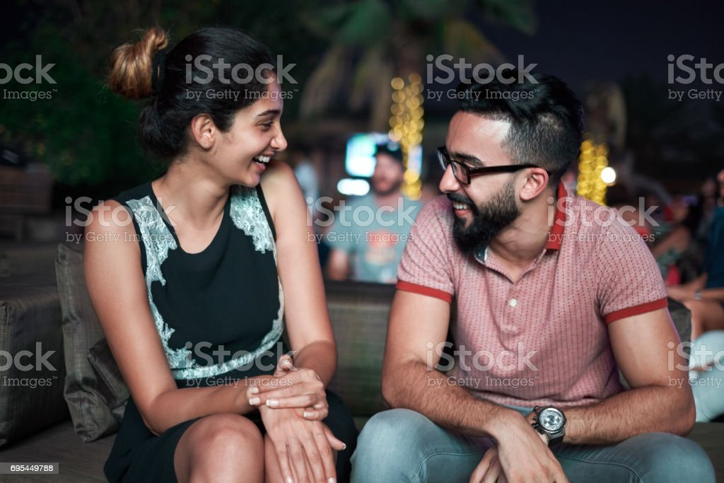 Young Arabs enjoying nightlife stock photo