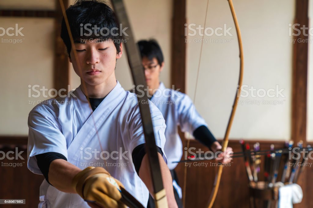 Young archer nocking an arrow stock photo