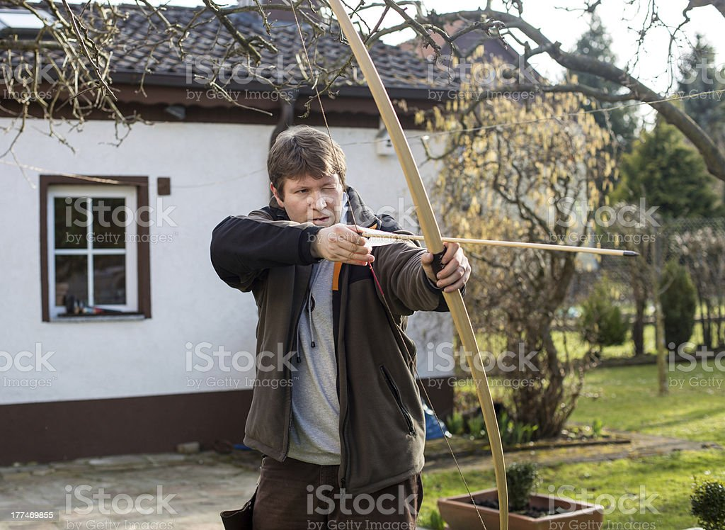 Young archer training with the bow stock photo