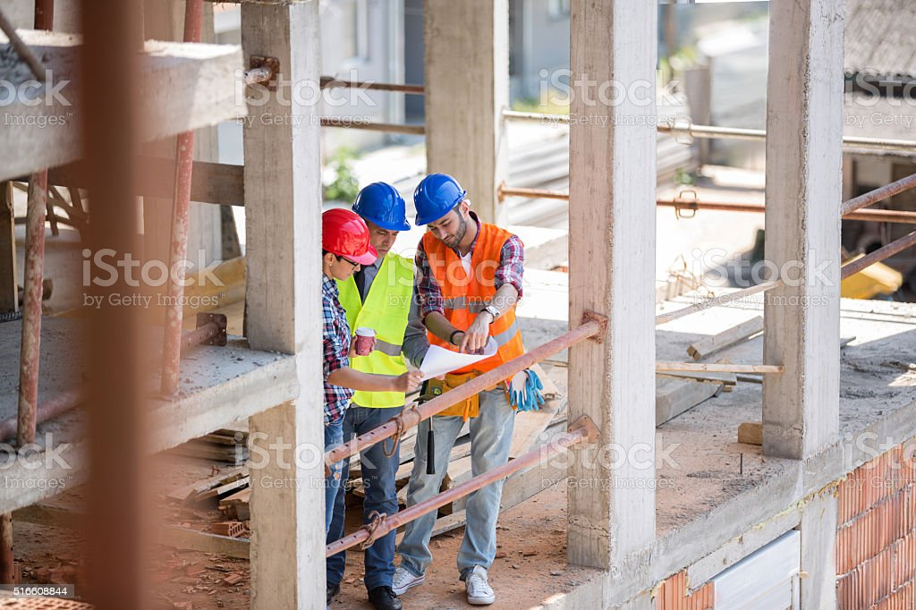 Young architect give suggestion to colleagues stock photo