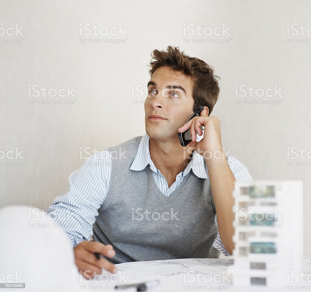 Young architect speaking on a cellphone royalty-free stock photo