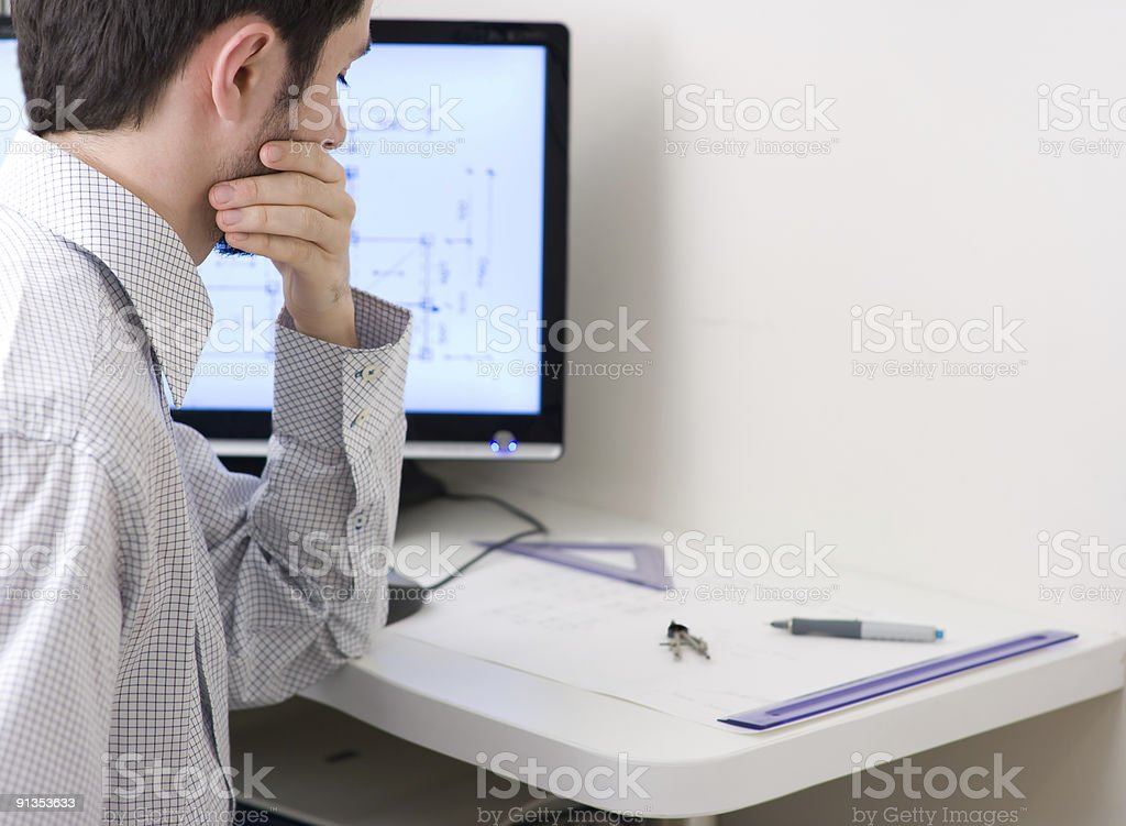 Young architect working on home project royalty-free stock photo