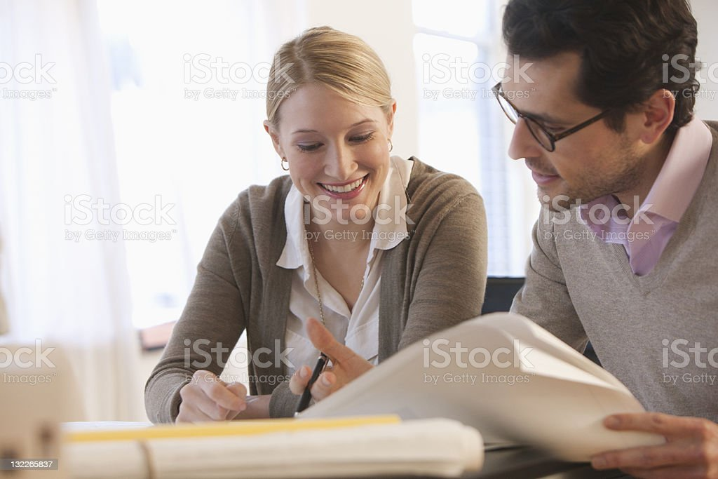 Young architects going over plans royalty-free stock photo