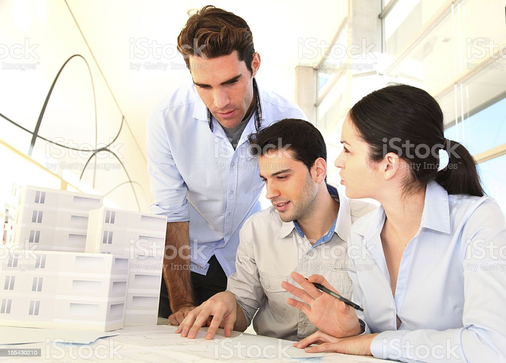 Young architects in business meeting royalty-free stock photo