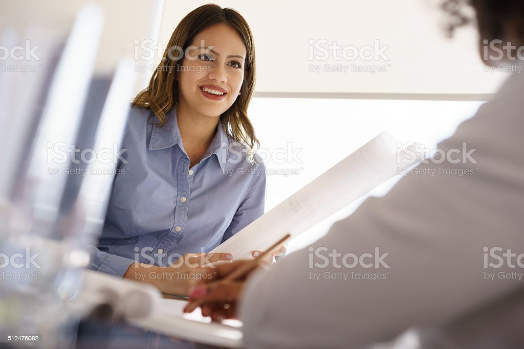 Young Architects Women Talking Plans And Housing Project stock photo