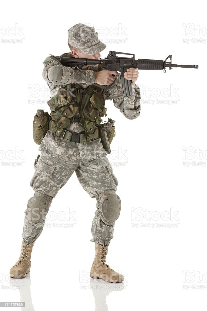 Young army man aiming with a rifle royalty-free stock photo