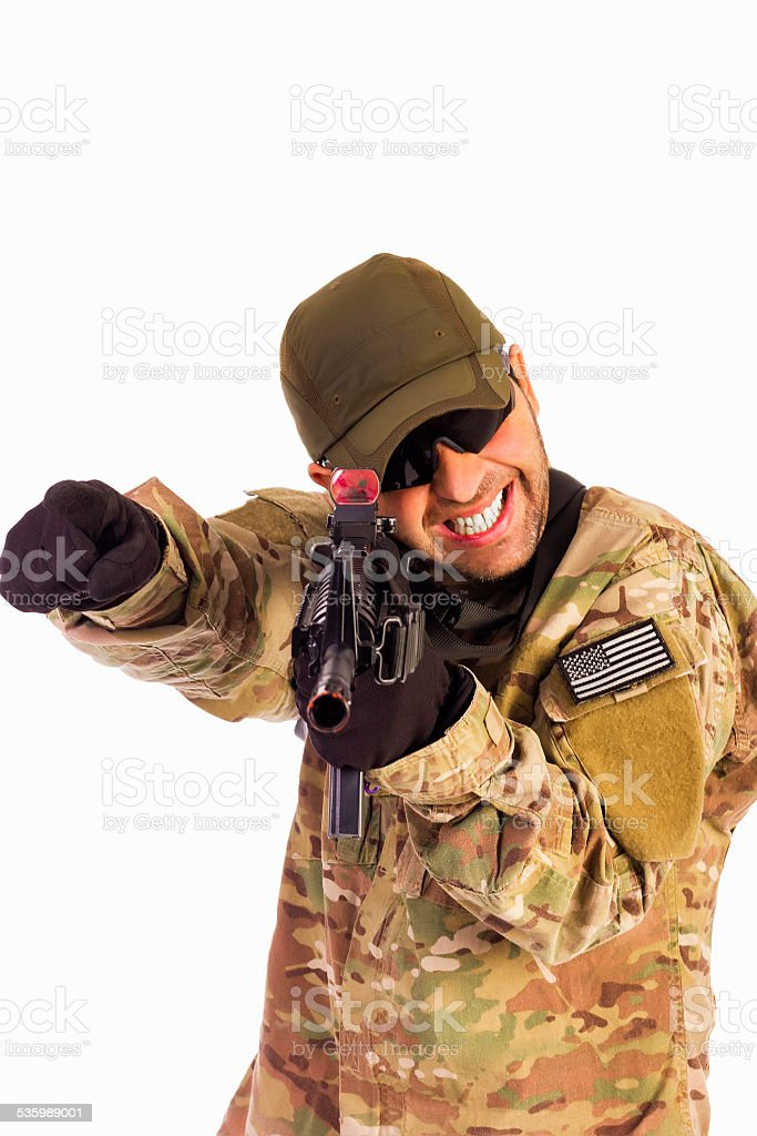 Young army soldier assaulting position stock photo