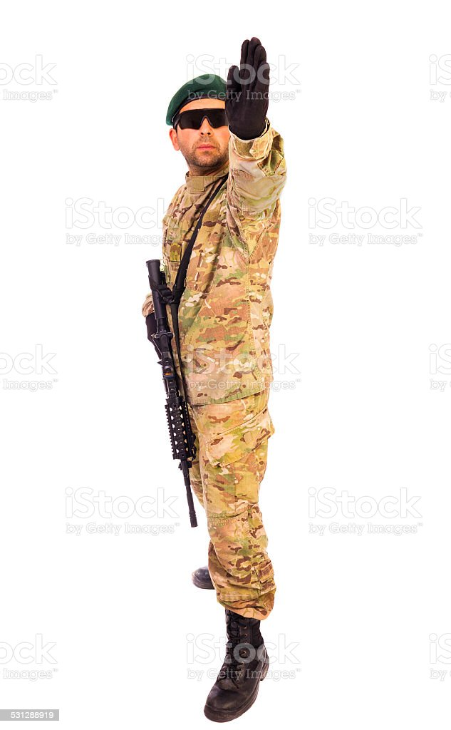 Young army soldier pointing out something stock photo