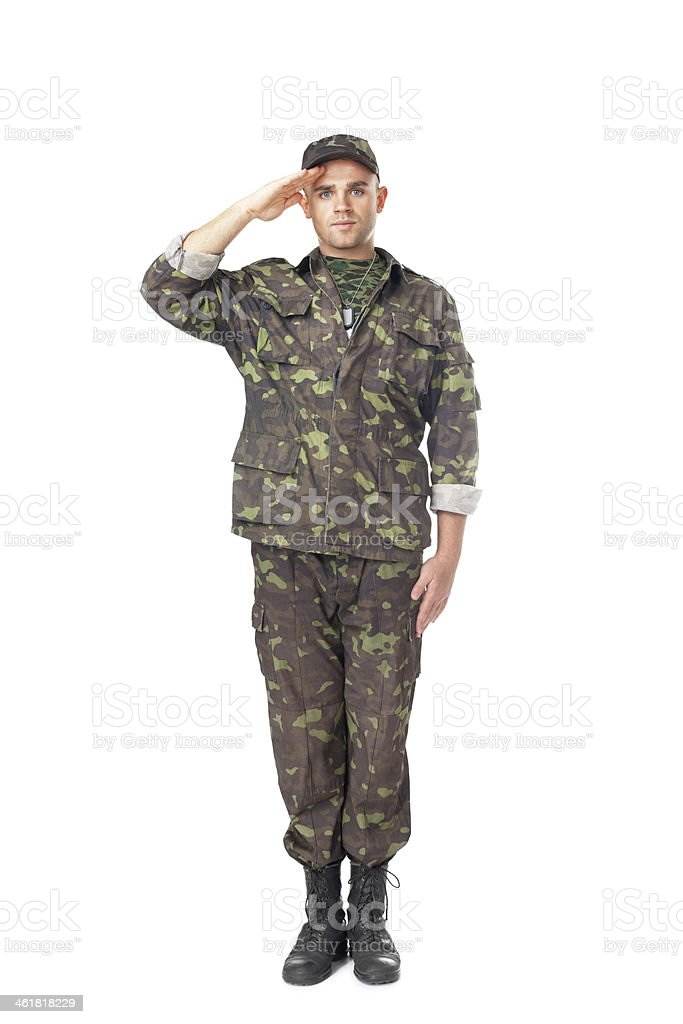 Young army soldier saluting stock photo