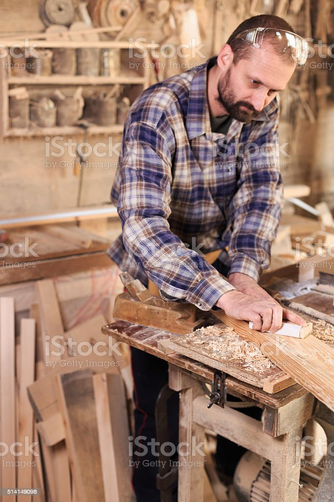 Young artisan manufacturing in his workshop stock photo