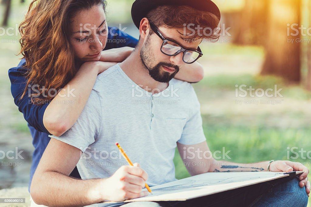 Young artist drawing in the park stock photo