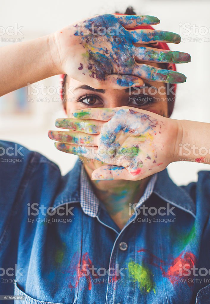 Young artist in mess stock photo
