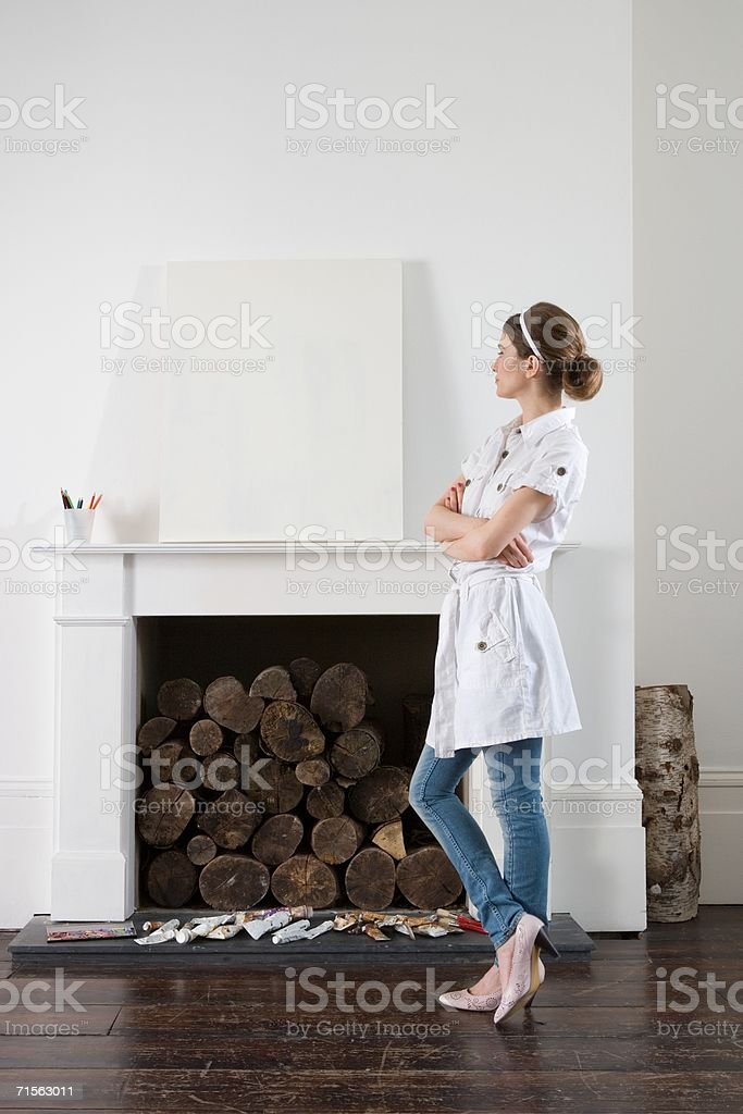 Young artist looking at blank canvas royalty-free stock photo