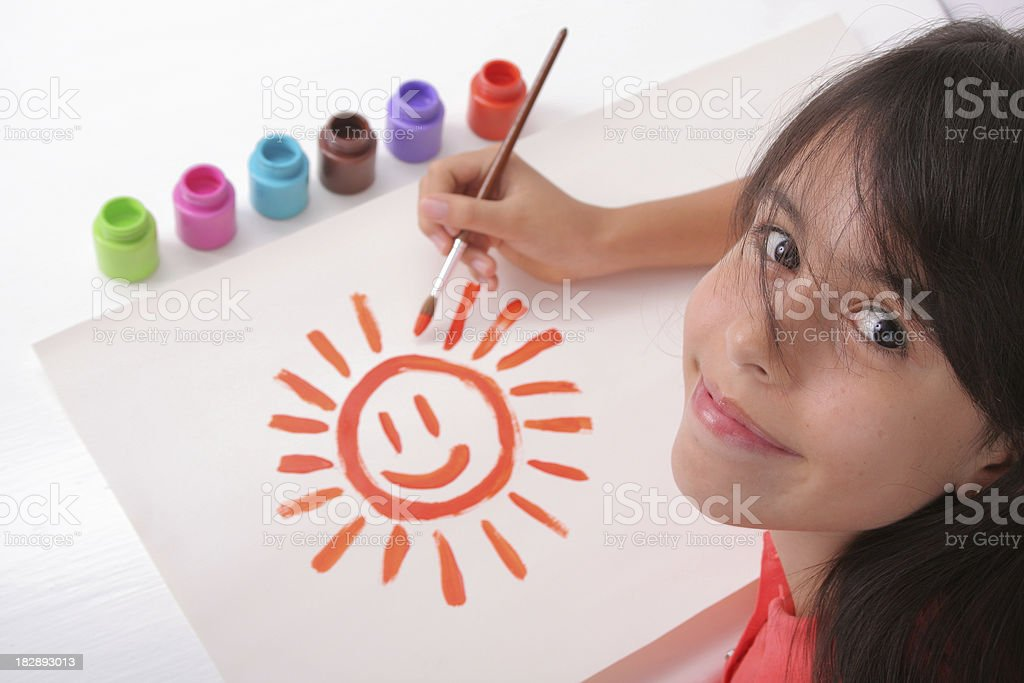 Young Artist Painting A Sun royalty-free stock photo