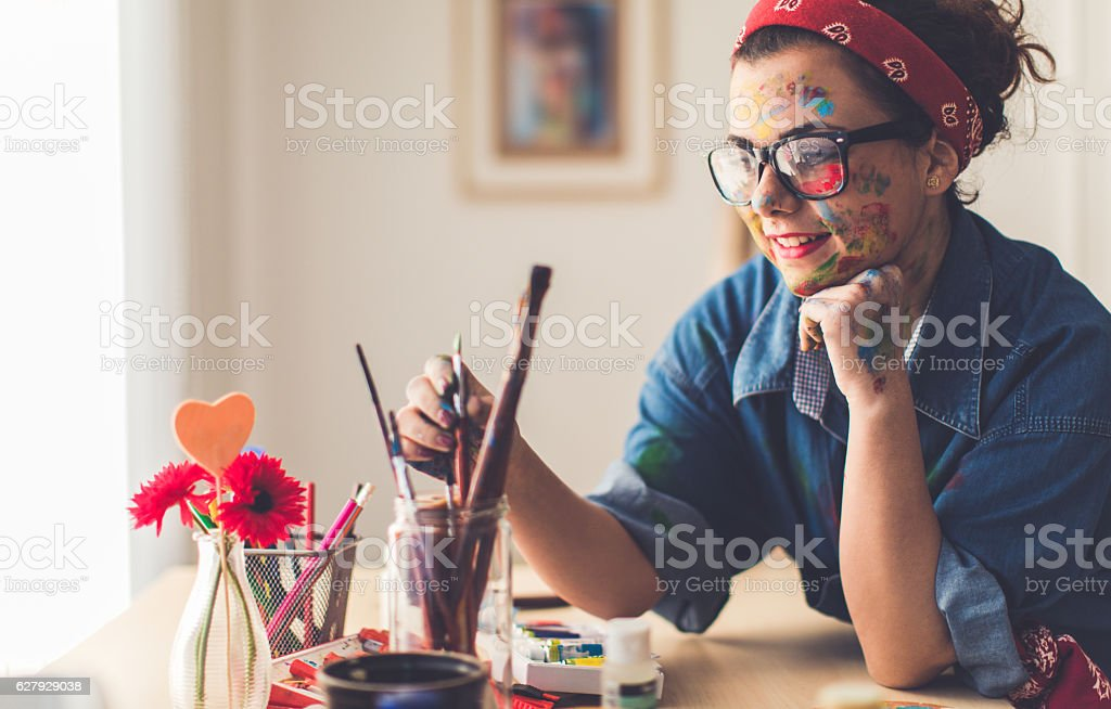 Young artist thinking of next project stock photo