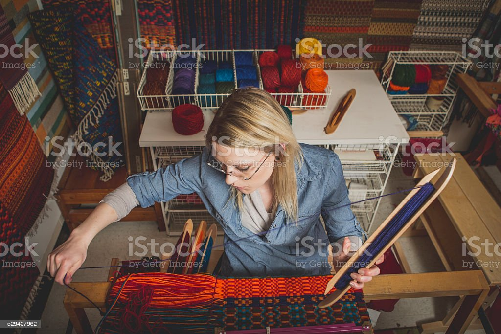 Young Artist Working on a Loom stock photo