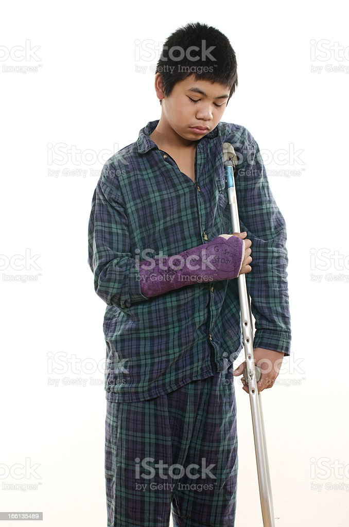 Young asian american boy with broken arm stock photo