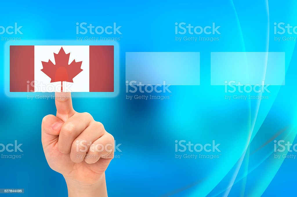 Young Asian boy hand touching button selecting Canadian option stock photo