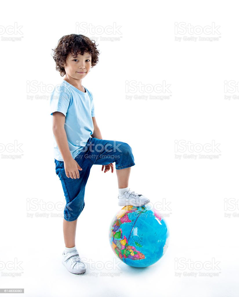 Young asian boy with a globe stock photo