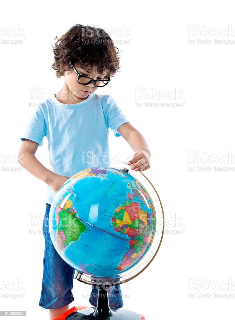 Young asian boy with globe against white background stock photo