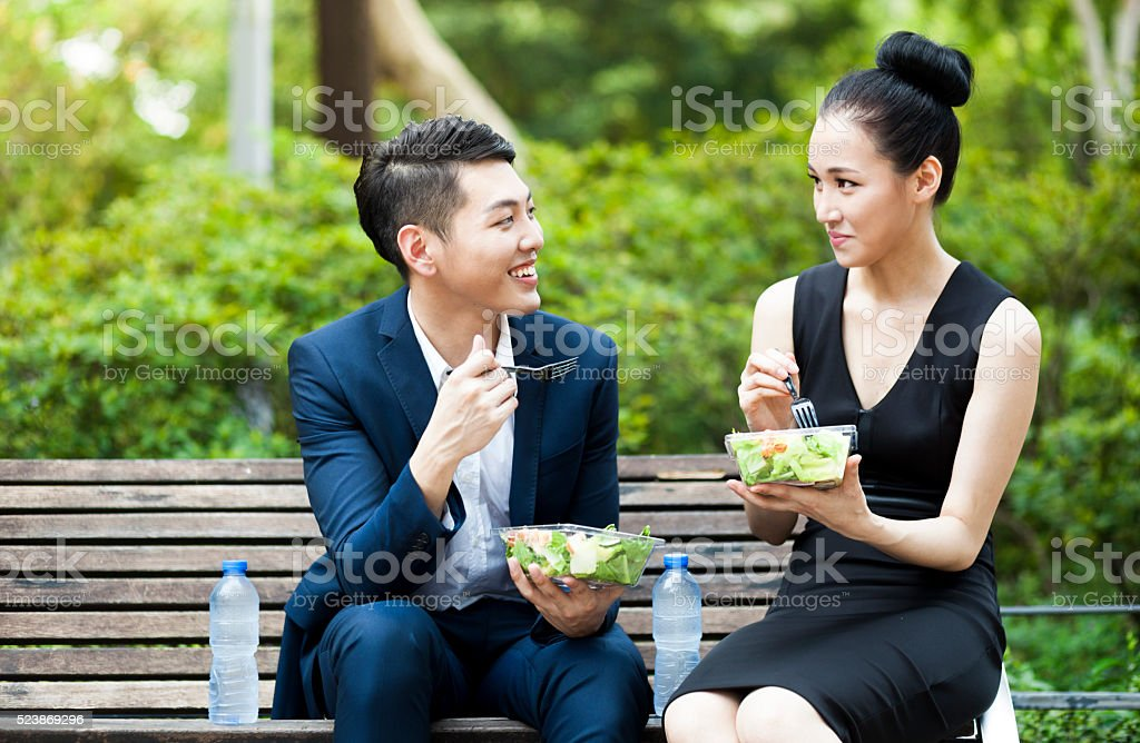Young Asian Business Colleagues Having Lunch stock photo