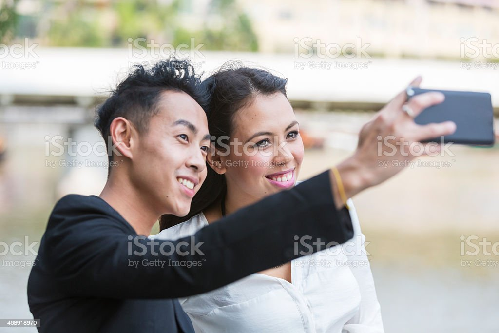 Young Asian Business Couple Selfie stock photo