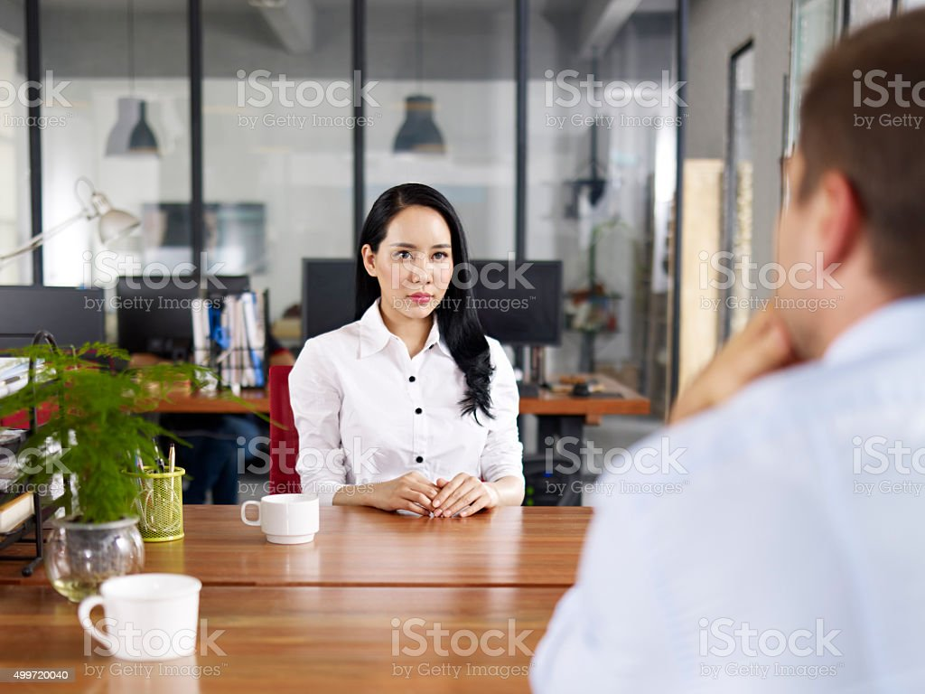 young asian business executive being interviewed stock photo