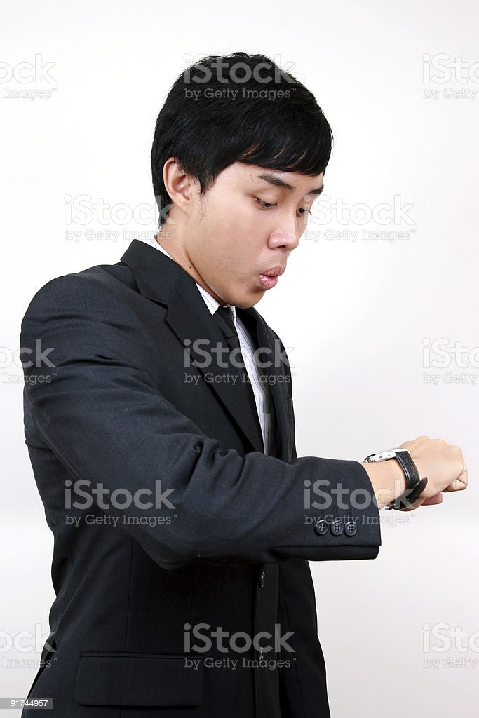 Young Asian Business man looking at his watch. royalty-free stock photo