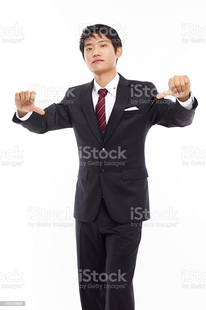 Young Asian business man show bed sign royalty-free stock photo