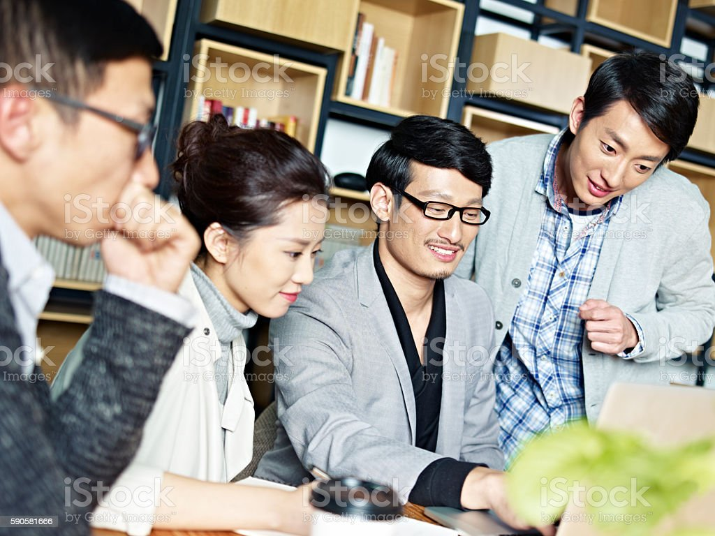 young asian business people working together in office stock photo